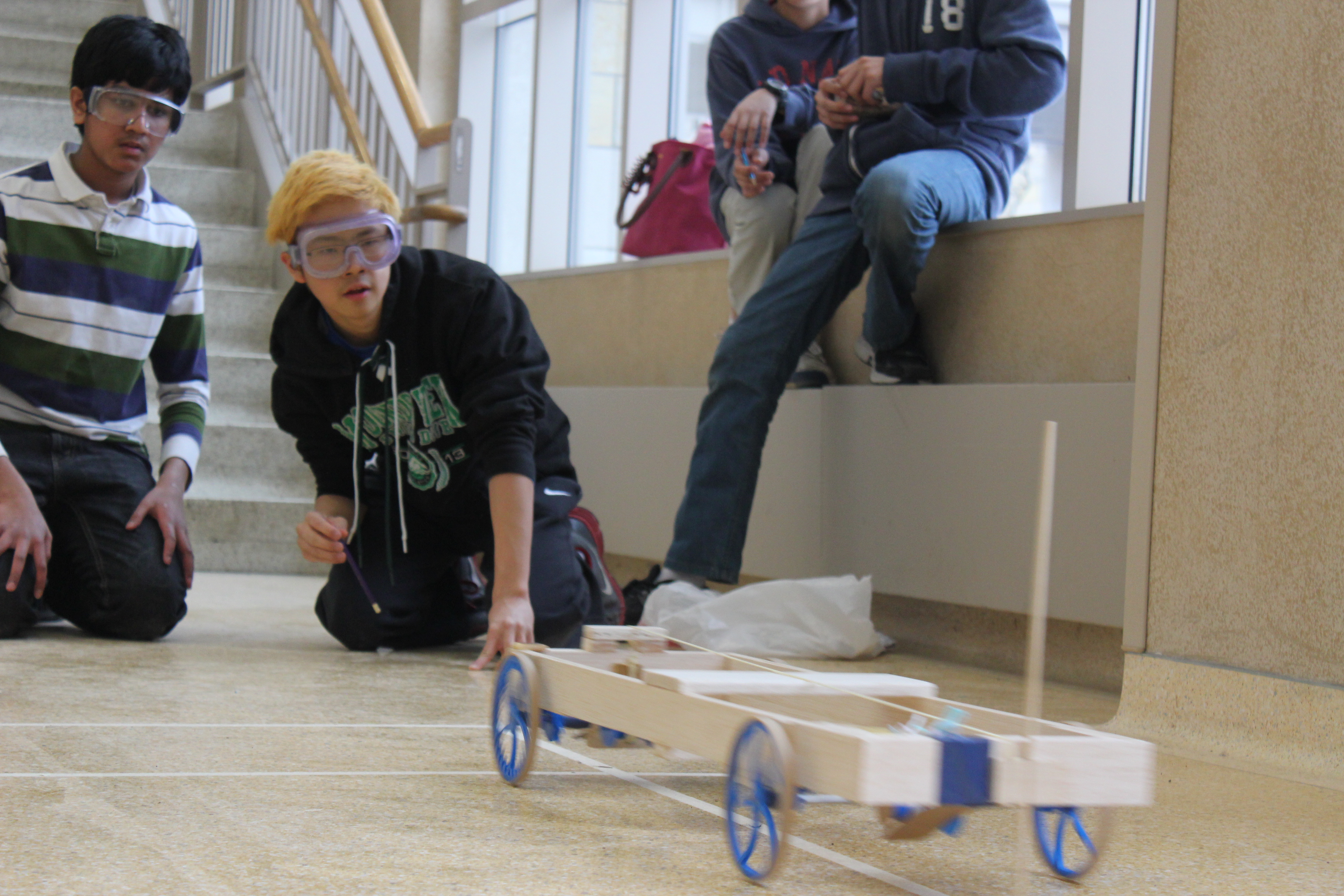 Students launching a wheeled vehicle in Science Olympiad